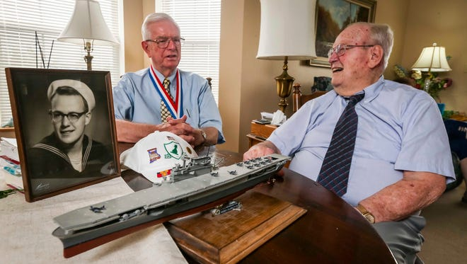 """Don Hauser, left, and Albert """"Skip"""" Braak, shown here Thursday, June 28, 2018, in Des Moines, are both veterans who survived the 1954 naval disaster aboard the USS Bennington that killed over 100 sailors and airmen. They met for the first time 60 years later, when they moved into the same retirement complex."""