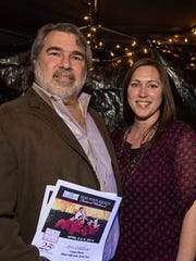 "Delaware-based filmmaker John Rusk and his daughter Kimberly Condie  in 2014 at the ""Dead Poets Society"" 25th anniversary celebration at the Everett Theater in Middletown."