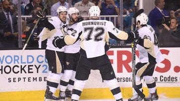 Pittsburgh Penguins defenseman Kris Letang (58) celebrates with teammates Sidney Crosby (87), Patric Hornqvist (72) and Conor Sheary (43) after scoring a goal against the San Jose Sharks during the Stanley Cup Final.