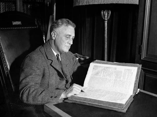 President-elect Franklin D. Roosevelt looks at a familiar chapter from Paul's first epistle to the Corinthians, in the family's Old Dutch Bible, at his home in Hyde Park, NY, Feb. 27, 1933. He'll place his hand on the passage when he takes the oath of office on Inauguration Day, March 4, 1933. The bible has been in the possession of the family since 1670.
