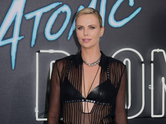 "Charlize Theron arrives at the LA Premiere of ""Atomic Blonde"" at The Theatre at Ace Hotel on Monday, July 24, 2017, in Los Angeles. (Photo by Willy Sanjuan/Invision/AP) ORG XMIT: CAWS206"