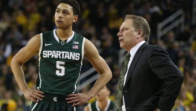 Michigan State coach Tom Izzo talks with Bryn Forbes during Tuesday's win at Crisler Center.