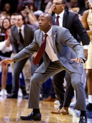 FILE - In this March 6, 2018, file photo, College of Charleston's head coach Earl Grant watches his team as they come back from a double-digit deficit against Northeastern in the second half of an NCAA college championship basketball game in the Colonial Athletic Association tournament at the North Charleston Coliseum in North Charleston, S.C. College of Charleston won 83-76 in overtime. The Cougars are back in the NCAA Tournament for the first time in 19 years, and for the first time since Doug Wojcik was fired amid allegations of verbal abuse of players, their families and staffers. (AP Photo/Mic Smith, File)