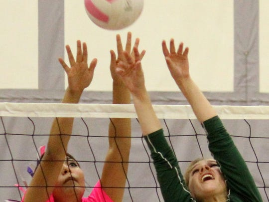 Cloudcroft's Sabina Judah, right, tries to push a ball over Mescalero's Lauryn Yuzos on Thursday night.