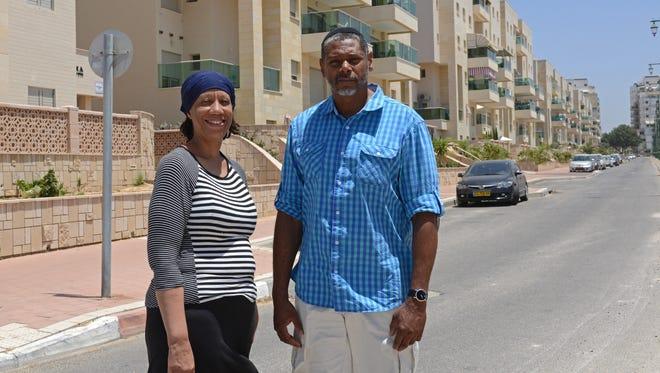 Tanya Avital Yehuda, 51, and Malachi Yehuda, 55, stand on an empty street in Ashkelon, Israel, on July 30, 2014.