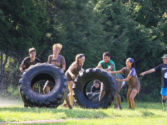 Metuchen's 'Proving Ground' mud run obstacle course brings teamwork skills to the student of Metuchen High School on August 19, 2017.  Alexandra Pais/ for the Courier News