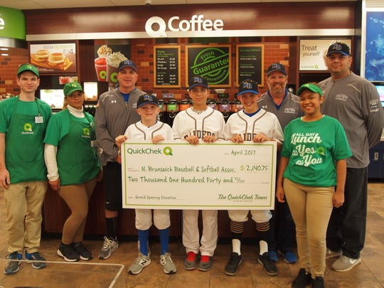 QuickChek donated $2,140.75 to the North Brunswick Baseball & Softball Association, making the presentation in the store on May 9. From left: QuickChek store team members Martin Prokai and Jessica Mejas, North Brunswick Baseball & Softball Association Vice President John Drury, players Conor Drury, Frank Garbolino and Zack Konstantinovsky, North Brunswick Baseball & Softball Association President David Rosenberg, coach Boris Konstantinovsky and store team member Juana Gonell.