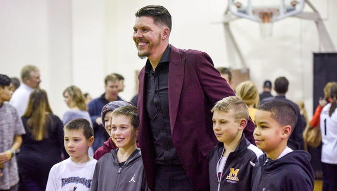 Mitchell native and professional basketball player Mike Miller poses for a photo with a group of young fans at the Mike Miller Classic.