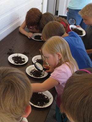 Children take part in a 4-H program in 2012 on vermiculture.