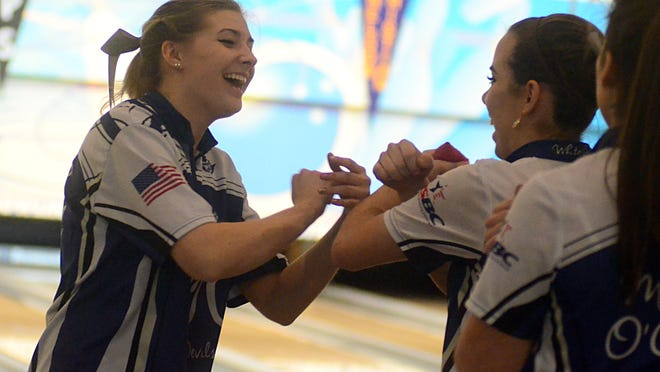 White House High senior Hannah Dowell (left) celebrates with classmate Anna O'Connor after a strike was bowled during Friday afternoon's semifinal win over Bartlett.