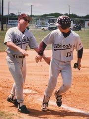 Calallen baseball coach Steve Chapman congratulates Mike McCreery during a game.