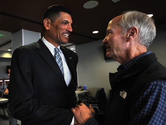 Jay Norvell, left, greets Chris Ault during his introductory press conference in December. Norvell has developed a close relationship with Ault to learn about the history of Nevada football.