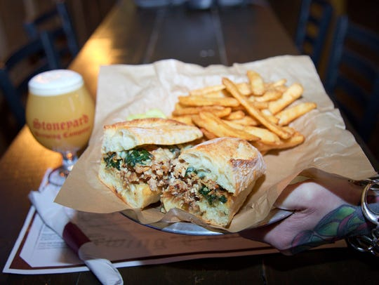 The porchetta sandwich at Stoneyard American Beer Hall