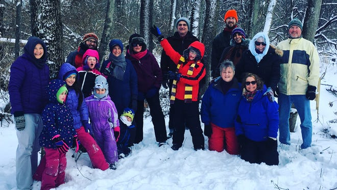 About 20 braved the wintry weather to participate in Freeville's First Hike.