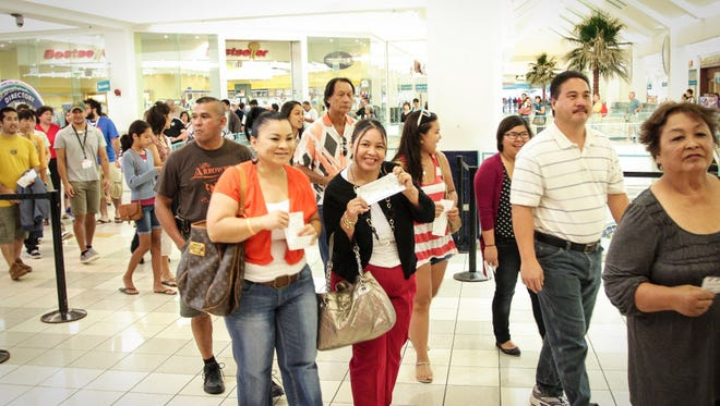 Crowds at at the Guam International Film Festival at the at Tango Theatres at the Agana Shopping Center are shown in this September 2015 file photo. The theater complex won't reopen.