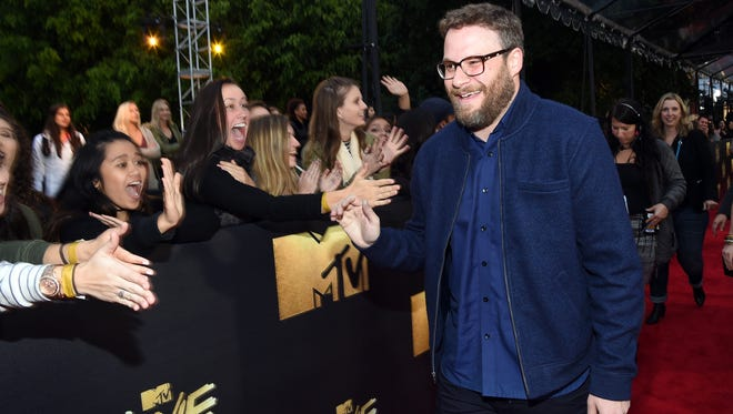 Seth Rogen meets fans before the taping of the MTV Movie Awards.