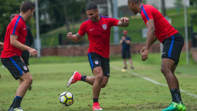Dom Dwyer grins as he kicks the ball with teammates during training with the U.S. Men's National soccer team at Lipscomb University in Nashville, Tenn., Monday, June 26, 2017.