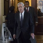 As Robert Mueller fights Russian interference, Trump is MIA