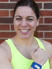 Katie McNeil qualified for the 121st Marathon Boston. She wore a Boston Strong wristband to serve as inspiration during her training.
