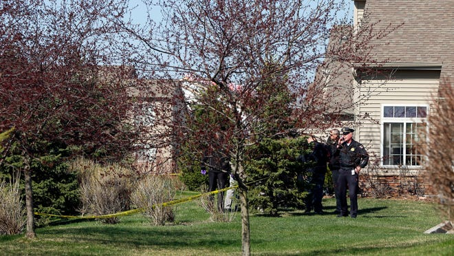 West Des Moines police investigate a body found in a drainage ditch in a neighborhood off EP True Parkway on Friday.