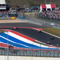 Cars speed by Turn 19 during the 2013 U.S. Grand Prix at the Circuit of the Americas.
