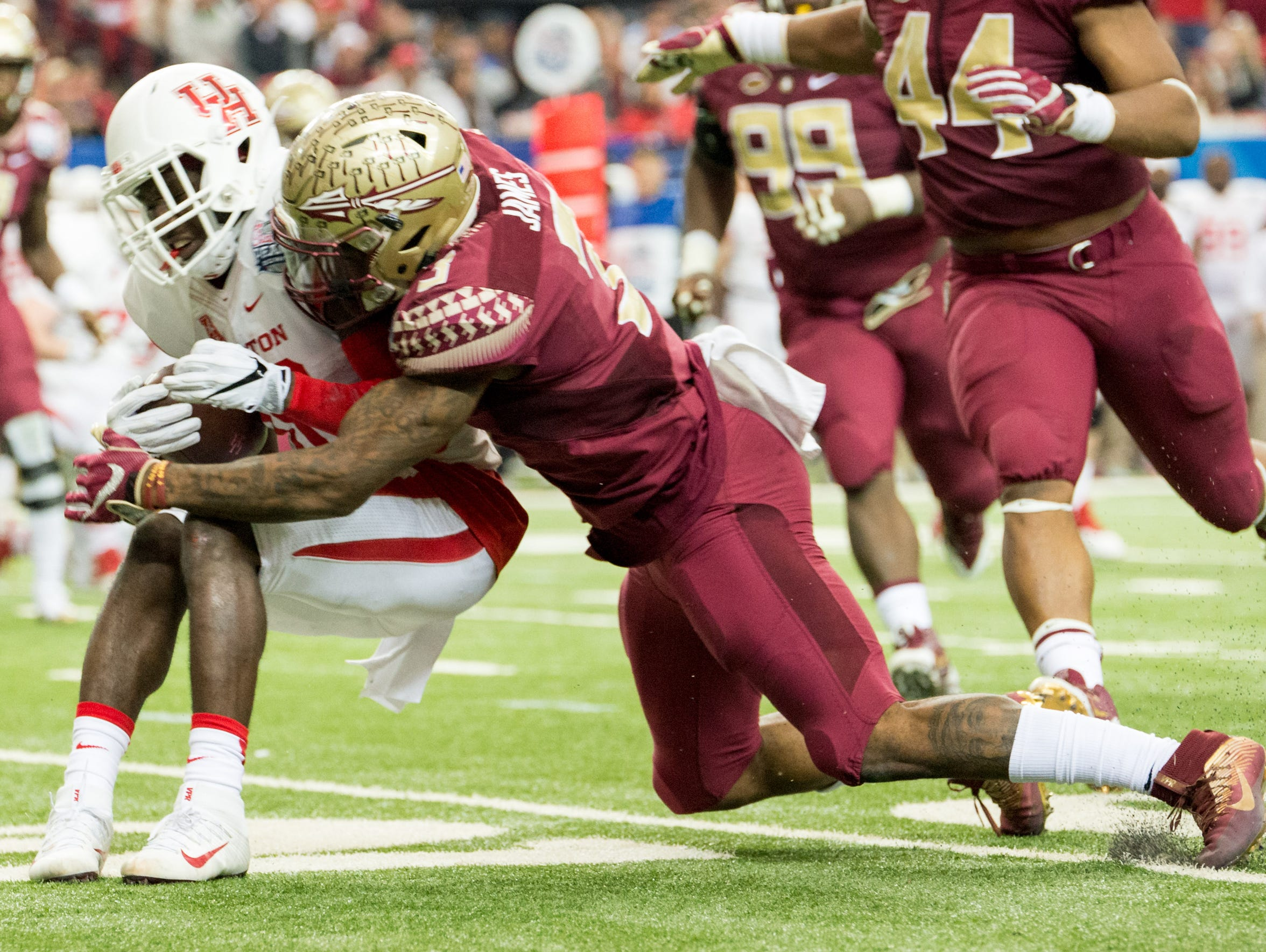 Derwin James makes a tackle during the Chick-Fil-A