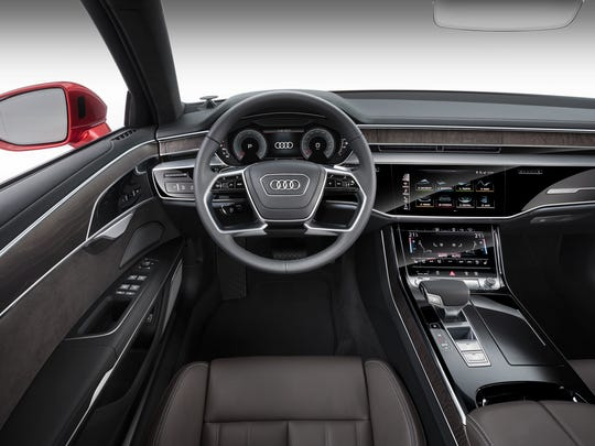 2019 Audi A8 has 'all-glass' centre console with touch screen controls.