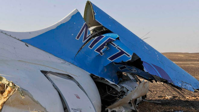 The tail of a Metrojet plane that crashed in Hassana, Egypt is shown on Oct. 31, 2015.