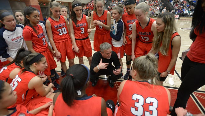 Saddle River Day coach Danny Brown talks to his players during the third-seeded Rebels' 51-39 victory over No. 1 Immaculate Conception in the Bergen County tournament final on Sunday.