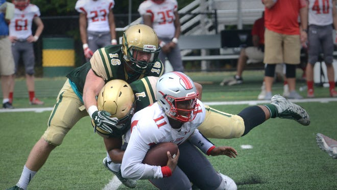 Dorian Hardy, seen here making a sack against St. John's College earlier this season, committed to Penn State on Sunday.