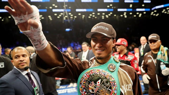 Mikey Garcia celebrates his win over Adrien Broner on Saturday.