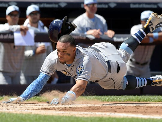 Tampa Bay Rays' Carlos Gomez scores on a two-RBI single