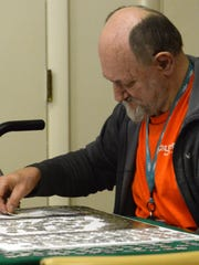 Bob Blosser works on a puzzle Thursday, May 17, 2018, at the Salvation Army Samaritan Center in Lancaster.