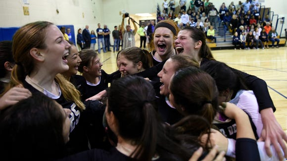 The River Dell girls volleyball team celebrates after capturing the Bergen County championship on Nov. 1, 2016 in Old Tappan.