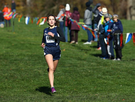 Morris Catholic's Kate McAndrew comes in to win the