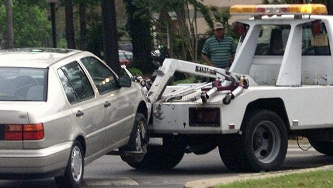 A car is towed away from an FSU parking lot by a DeLoach truck recently. Photo to accompany Tony Bridges story on towing.
