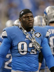 Detroit Lions defensive end George Johnson.