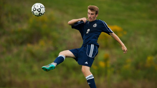 Essex's Aidan Whitney (2) kicks the ball during the boys varsity soccer game against CVU on Wednesday in Hinesburg.