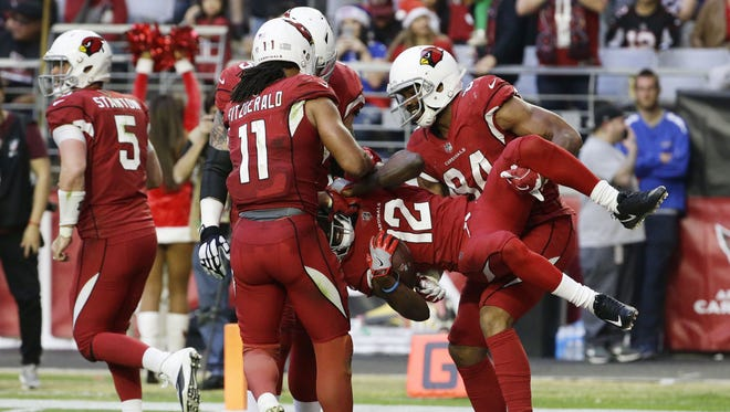 Arizona Cardinals wide receiver John Brown is carried from the end zone after scoring a touchdown against the New York Giants in the second half on Dec. 24, 2017 at University of Phoenix Stadium in Glendale, Ariz.