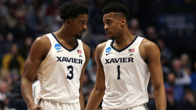Xavier Musketeers guard Quentin Goodin (3), left, and Xavier Musketeers guard Paul Scruggs (1) talk during a timeout in the first half of the second-round West Region NCAA Tournament game between the Xavier Musketeers and Florida State Seminoles, Sunday, March 18, 2018, at Bridgestone Arena in Nashville.