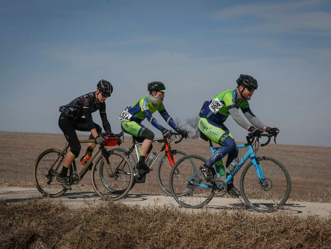 Cyclists make their way across gravel during the CIRREM