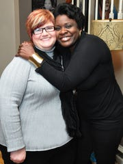 Shelia Willis celebrates with a guest, Tina Mercer,