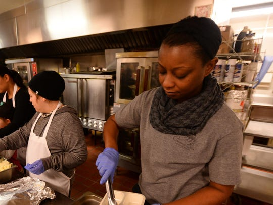 Volunteers put together turkey dinners for Meals on