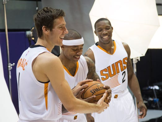 Suns' Goran Dragic (L-R), Isaiah Thomas and Eric Bledsoe laugh during a shot during Media Day at US Airways Center in Phoenix, AZ on Monday, Sept. 29, 2014.