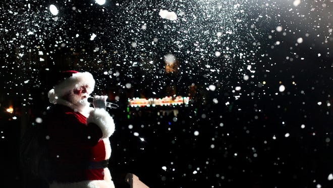 Santa Claus addressed the crowd during Light Up Louisville in 2011.