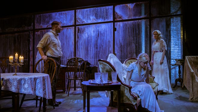 """Eric D. Pasto-Crosby, Elliott Sikes (seated) and Nan Gurley perform in Studio Tenn's production of the Tennessee Williams classic """"The Glass Menagerie."""""""