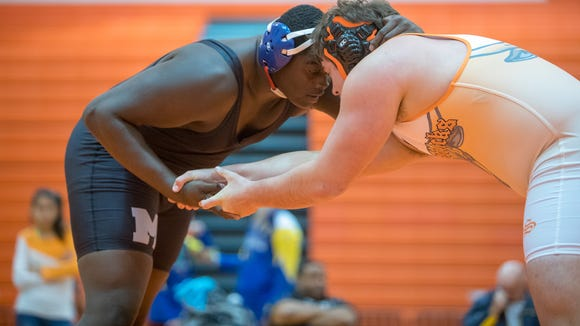 J.L. Mann's Zion Robinson-Kearse, left, will be among the seniors on the North AAAAA/AA/A roster in the Best Western North-South Wrestling All-Star Classic March 2-3 at North Myrtle Beach High School.