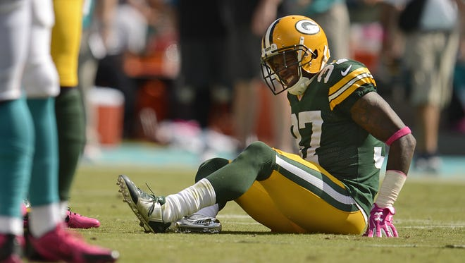 Green Bay Packers cornerback Sam Shields grimaces after injuring a knee during the third quarter of Sunday's game against the Miami Dolphins at Sun Life Stadium in Miami Gardens, Fla.