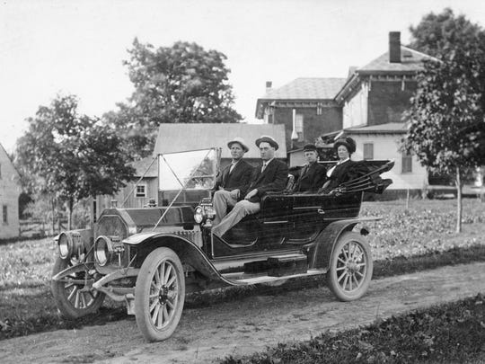 Here's the Friend family going out for a drive in the Rushville area in 1910. In the front seat is Charles and Dudley. In the back seat is Clifford and Blanche. Notice the tires on the car have already become wider since the earlier 1900s, but check out the ever-important tool box on the running board to make repairs as they ventured along the streets.