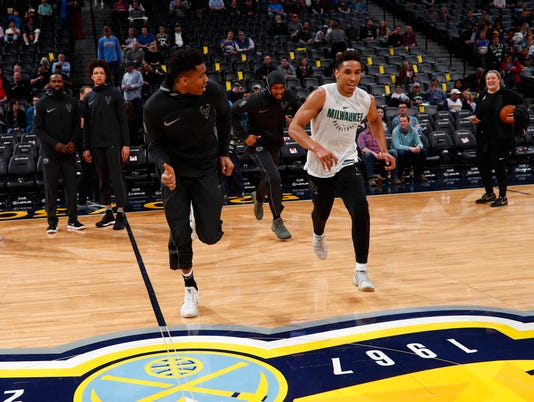 Milwaukee Bucks forward Giannis Antetokounmpo (34), Milwaukee Bucks guard Malcolm Brogdon (13)